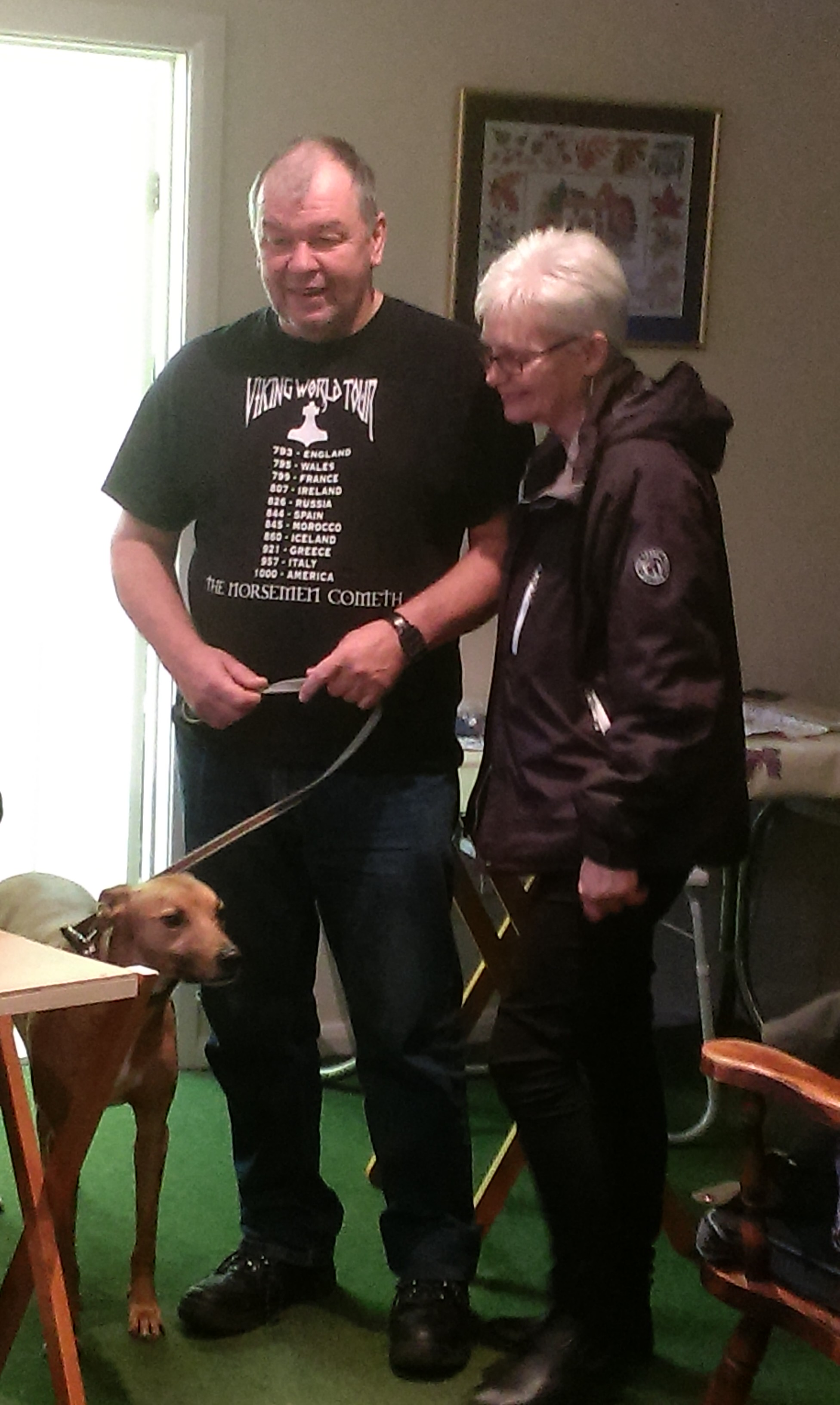 Tom, his wife Theresa, and their dog Toby, at a tapestry project meeting